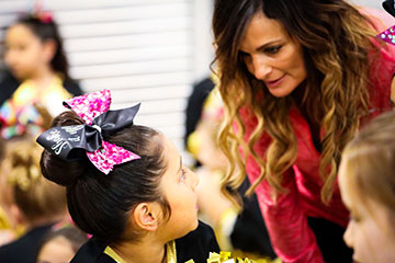 Cheerleading Instructor working with Student
